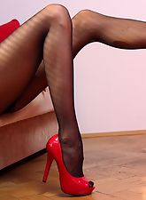 Extremely long and sexy MILF legs in sheer black pantyhose