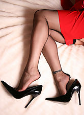Hot Nadja in red Dress and black fully fashioned Nylons on bed
