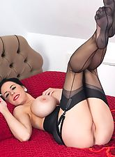 Louise strips and gets her lovely nylon feet ready for attention